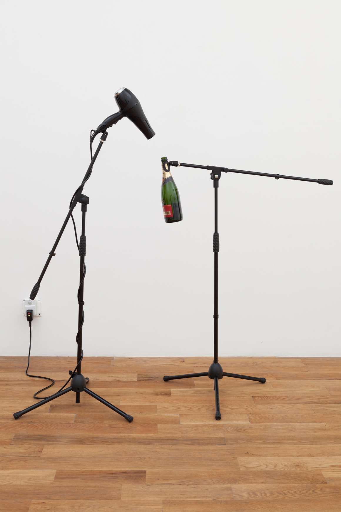 "<p><span class=""name"">Sarah Schönfeld</span><br><em>Sirens</em><span class='media'>Microphone stands, blowdryer, champagne bottle, motion activated switch</span>Variable<br>2016<br><a class='inquire' href='mailto:info@gildargallery.com?subject=Artwork Inquiry SSCH0001&body=I am interested in finding out more about Sirens by Sarah Schönfeld'>Inquire</a></p>"