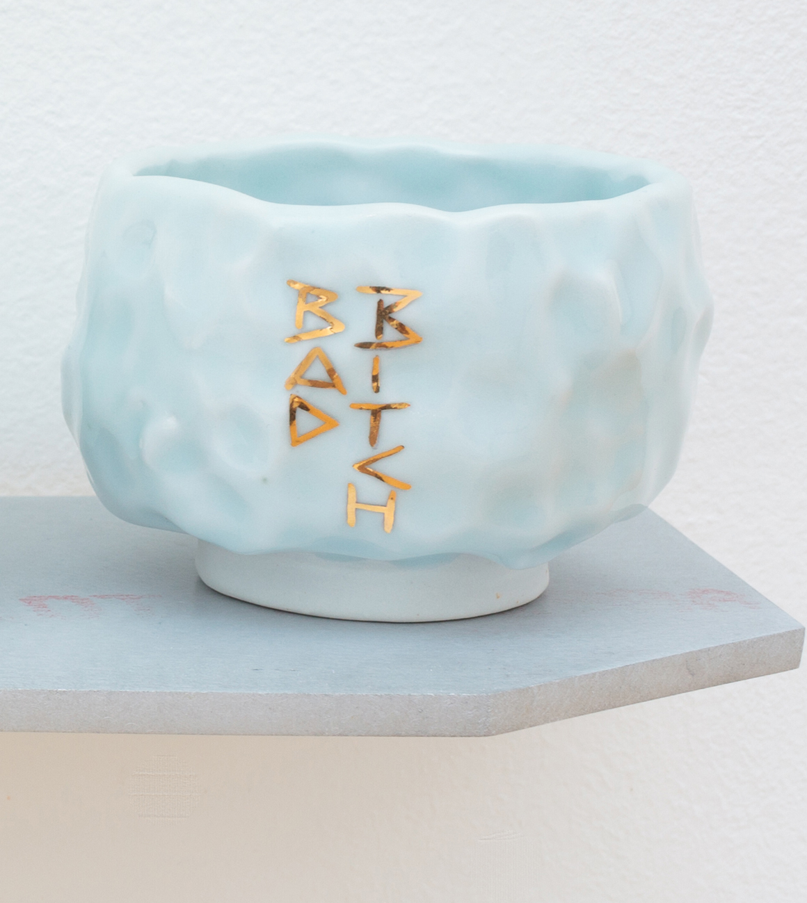 "<p><span class=""name"">Patrice Renee Washington</span><br><em>Bad Bitch Cup (1)</em><span class='media'>Glazed porcelain, gold luster, aluminum, Sculpey clay</span>2.5 x 3 x 3 in (6.4 x 7.6 x 7.6 cm)<br>2016<br><a class='inquire' href='mailto:info@gildargallery.com?subject=Artwork Inquiry PWAS0002&body=I am interested in finding out more about Bad Bitch Cup (1) by Patrice Renee Washington'>Inquire</a></p>"