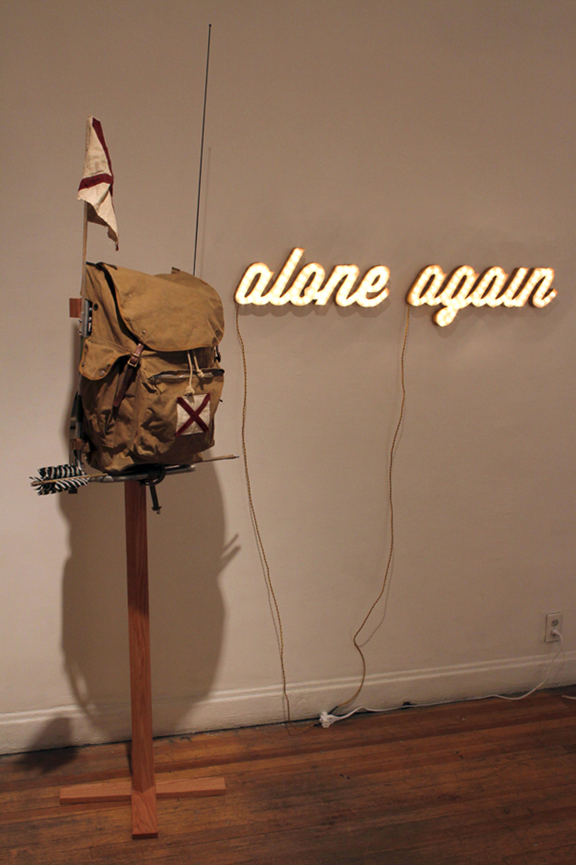 """<p><span class=""""name"""">Ryan Everson</span><br><em>Alone Again (Pack)</em><span class='media'>vintage scout pack, handmade bamboo arrows, radio, canvas patches and flag, oak stand</span>78 x 31 1/2 x 16in<br>2013<br><a class='inquire' href='mailto:info@gildargallery.com?subject=Artwork Inquiry REVE0006&body=I am interested in finding out more about Alone Again (Pack) by Ryan Everson'>Inquire</a></p>"""